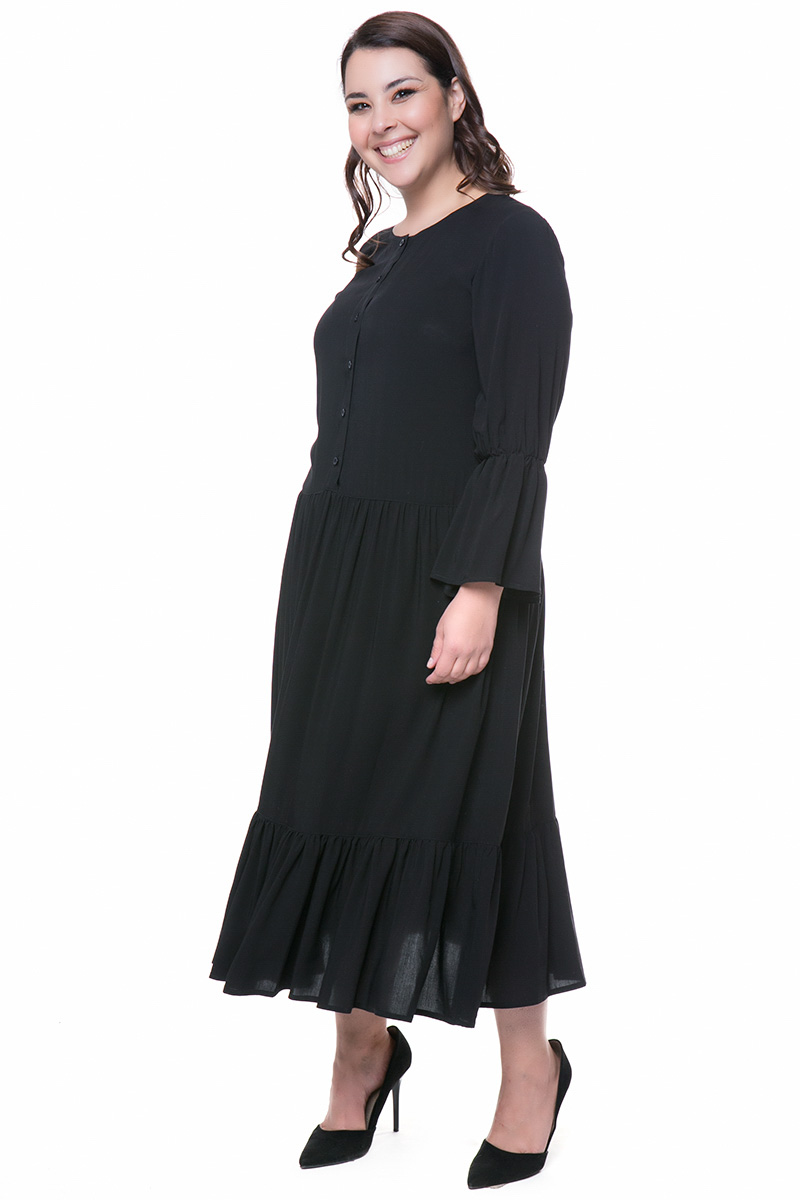 66226f45b1da Φόρεμα maxi Χρώμα μαύρο Μακριά μανίκια Διαθέτει τελείωμα με βολάν κουμπάκια  στο πάνω μέρος Κλειστή λαιμόκοψη