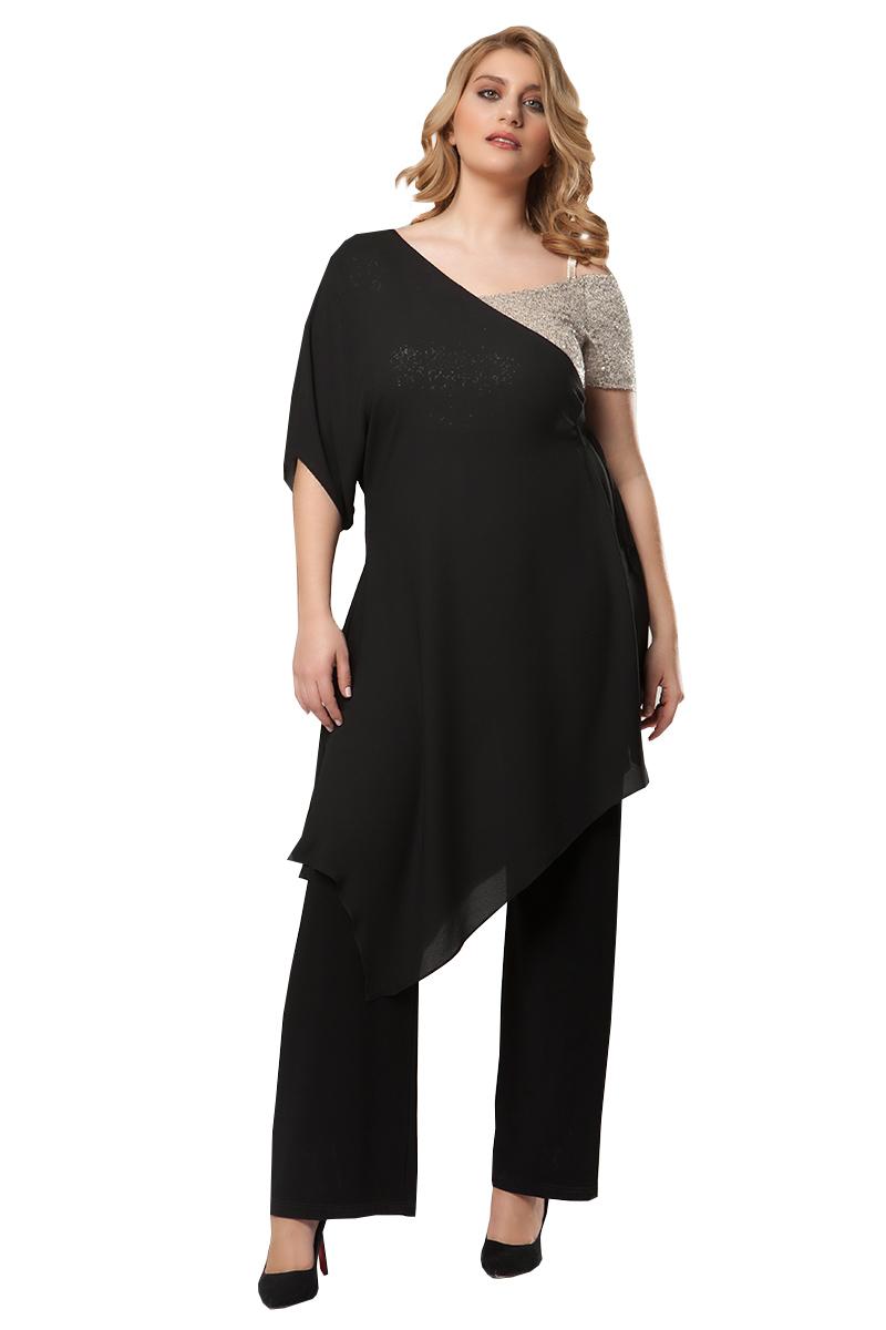 7bfc6e323bd0 Ολόσωμη φόρμα Μαύρο χρώμα Τοπ με παγιέτες Διαθέτει ημιδιάφανη τουνίκ στο  πάνω μέρος Ανοιχτή λαιμόκοψη Η